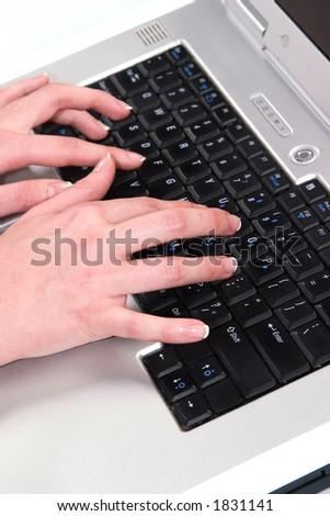 hand on computer keyboard - stock photo