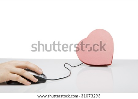 hand on computer mouse connected to red heart
