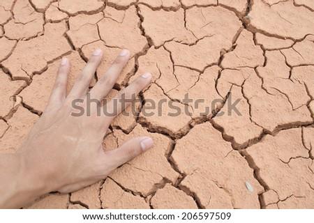 hand on Dry soil - stock photo