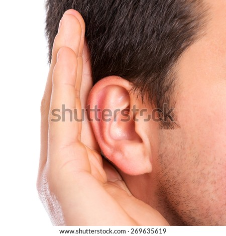 Hand on ear listening for quiet sound - stock photo