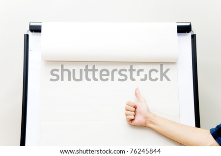 hand on flip chart - stock photo