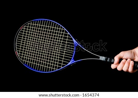 Hand on grip and swinging a tennis racket. Isolated on black background.