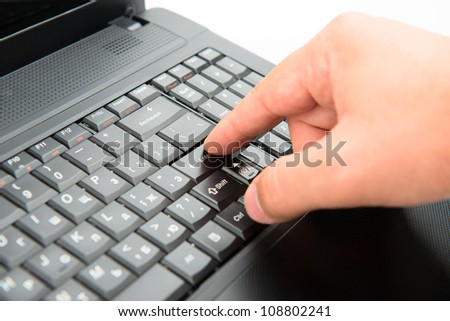 Hand on keyboard pushes button enter - stock photo