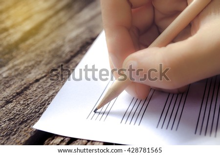 hand on music sheet - stock photo