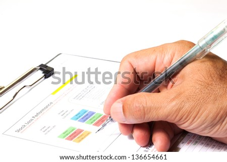 Hand on paperwork