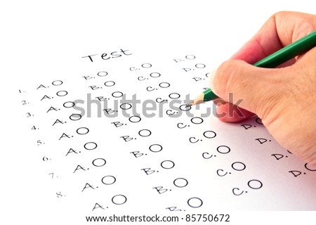 Hand on pencil choosing the test list on the examination - stock photo