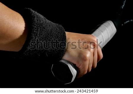 Hand on tennis racket  - stock photo