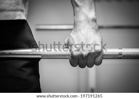 hand on the barbell - stock photo