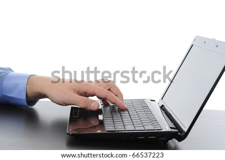 Hand on the laptop keyboard. Isolated on white - stock photo