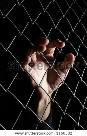 Hand on wire - stock photo