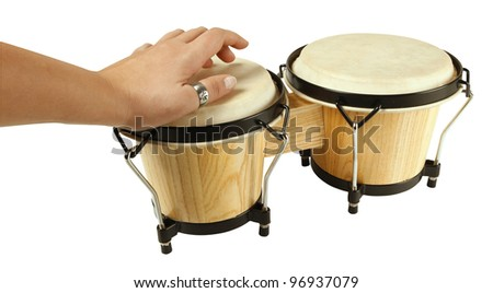 Hand on wooden bongo drums - stock photo