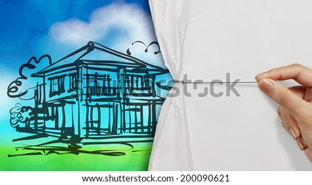 hand open crumpled paper to show dream house and green nature background as concept  - stock photo