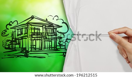 hand open crumpled paper to show sketch of house green nature background as concept  - stock photo
