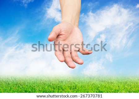 hand open palm gesture on sot focused effect of nature  background  - stock photo