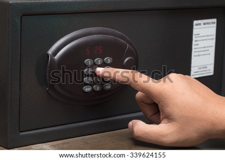 Hand opening a safe. - stock photo