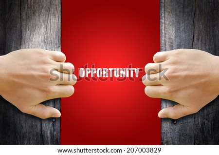"Hand opening a wooden door found the word ""OPPORTUNITY"". - stock photo"