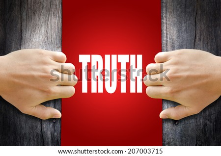 """Hand opening a wooden door found the word """"TRUTH"""". - stock photo"""
