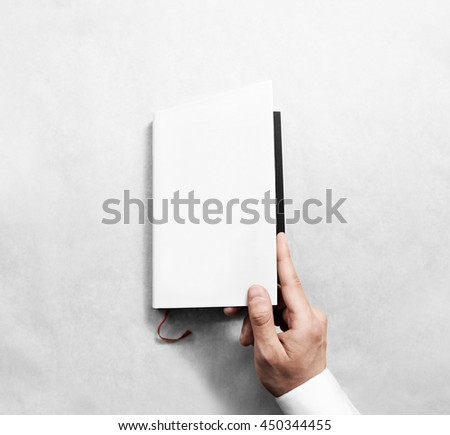 Hand opening blank white book cover mockup template. Clear booklet front surface design mock up. Arm holding opened textbook diary. Reading clean notebook copy. Closed catalogue presentation display. - stock photo