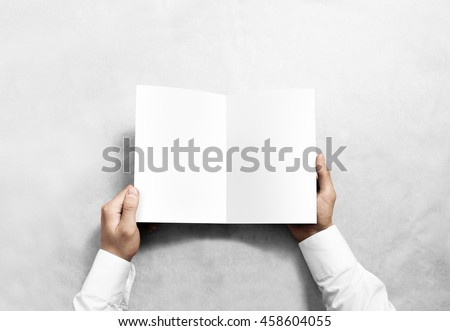 Hand opening blank white brochure booklet mockup. Leaflet presentation. Pamphlet mock up holding hand. Man show clear offset paper. Booklet design template. A5 paper sheet display read first person