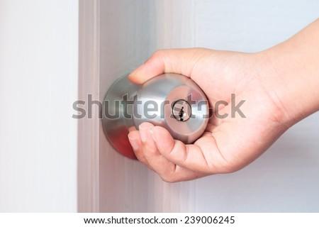 hand opening door - stock photo