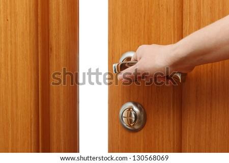 Hand opening the door. Horizontal format - stock photo