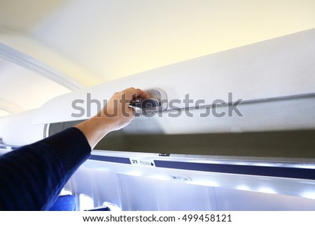 Hand opening white panel for luggage