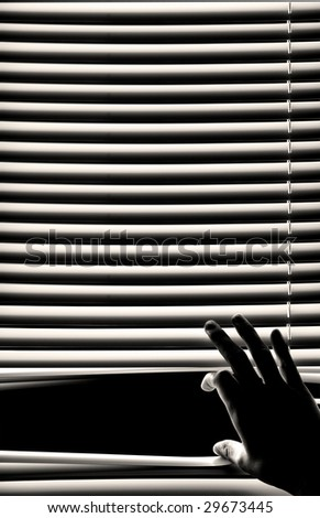 hand opening window blinds - stock photo