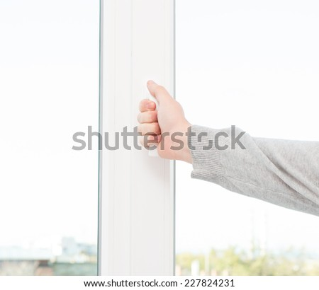 Hand opens a window - stock photo