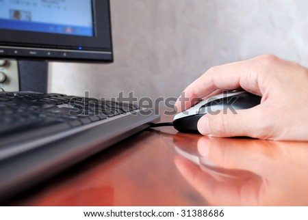 hand operating a mouse of computer - stock photo