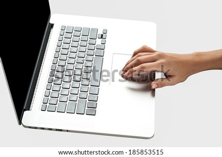 Hand operating on laptop's track pad