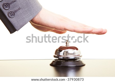 Hand over a hotel bell on a counter