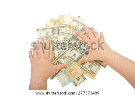Hand over a pile of money isolated on white background