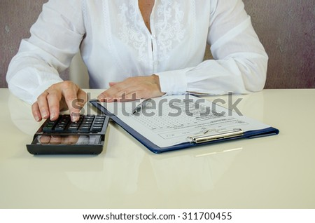 hand over calculation and paperwork - stock photo