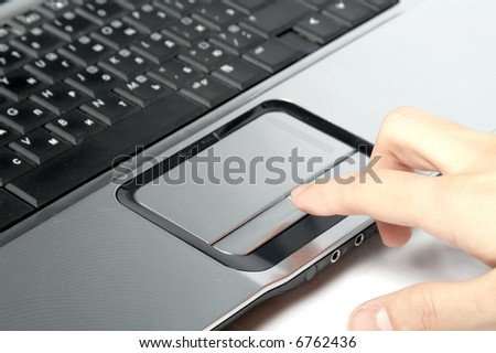hand over laptop on white background - stock photo