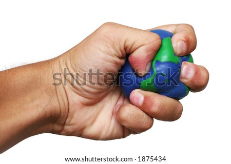 Hand over white with crushed planet earth - stock photo