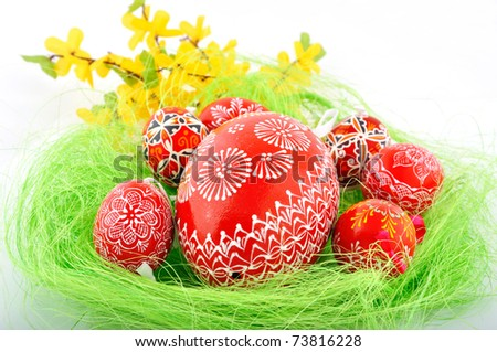 Hand painted czech easter eggs in fresh green grass - stock photo