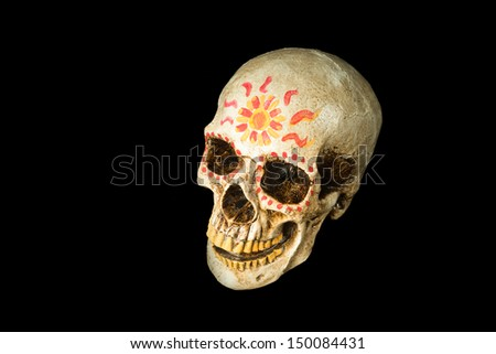 Hand painted Dia de los Muertos (Day of The Dead) skull isolated on black background - stock photo