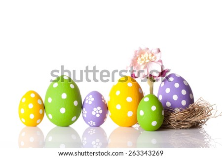 Hand painted Easter eggs and flower isolated on white background.