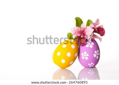 Hand painted Easter eggs and flower isolated on white background. - stock photo