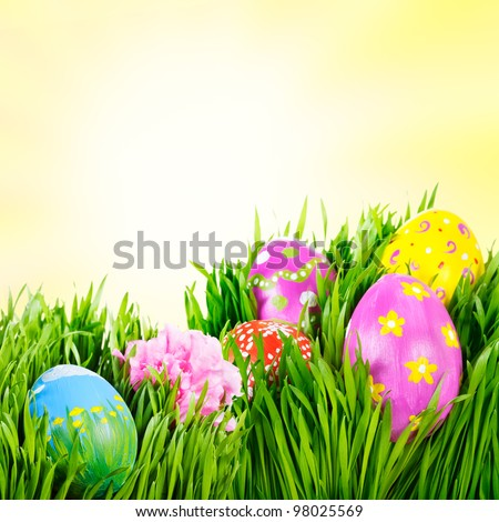 Hand painted Easter eggs nestled in the grass