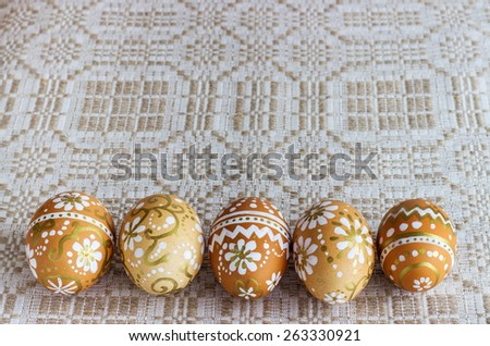 hand-painted Easter eggs on a cloth background - stock photo