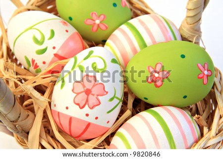 Hand painted easter eggs. Shallow depth of field, focus on the two main front eggs. - stock photo