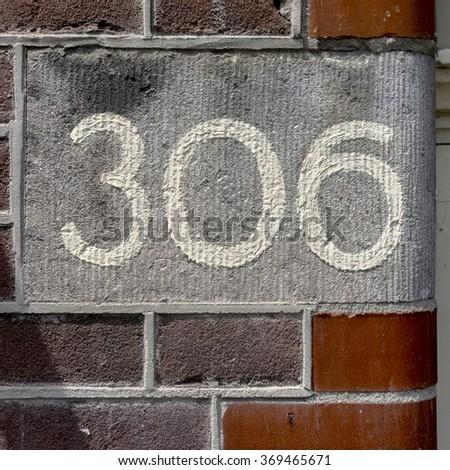 hand painted house number three hundred and six. - stock photo