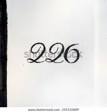 hand painted house number two hundred and twenty six - stock photo
