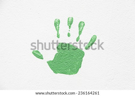 Hand painted on the wall, detail of a hand painted green textured background, silhouette  - stock photo