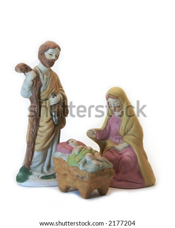 Hand painted porcelain figures depicting Mary Joseph and Baby Jesus. - stock photo