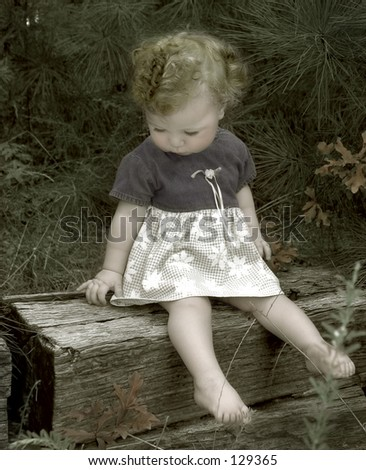 hand painted vintage look-toddler sitting on a crosstie - stock photo