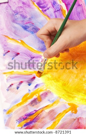 hand painting a sun, fluorescent colors - stock photo