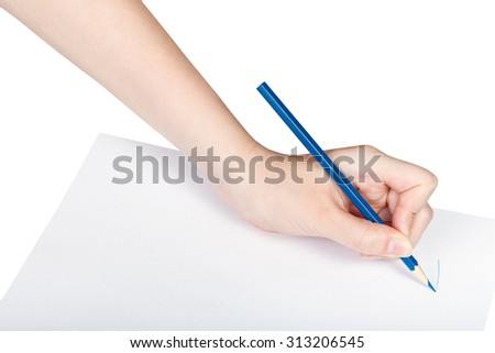 hand paints by blue pencil on sheet of paper isolated on white background