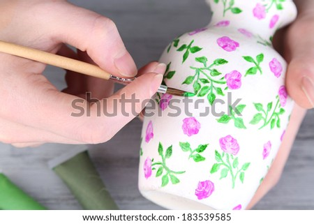 Hand paints on hand made vase and art materials - stock photo